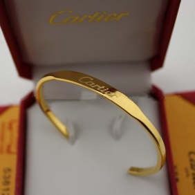 Faux Cartier collection logo bracelet Yellow gold open bangle