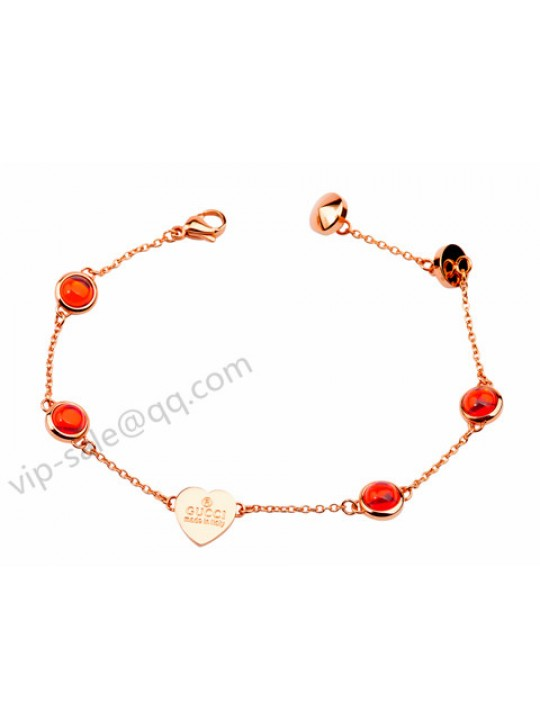 Gucci with 4 red diamond bracelet in pink gold