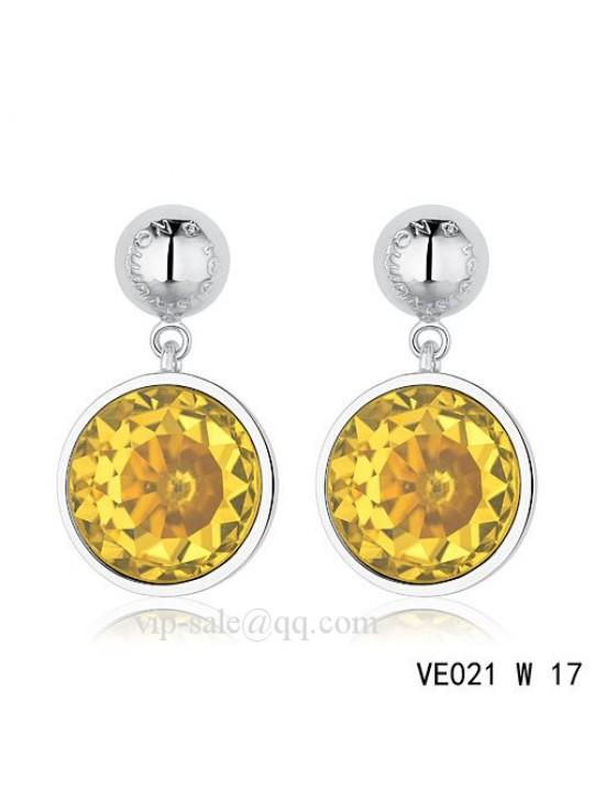 Louis Vuitton topaz crystal earrings in white