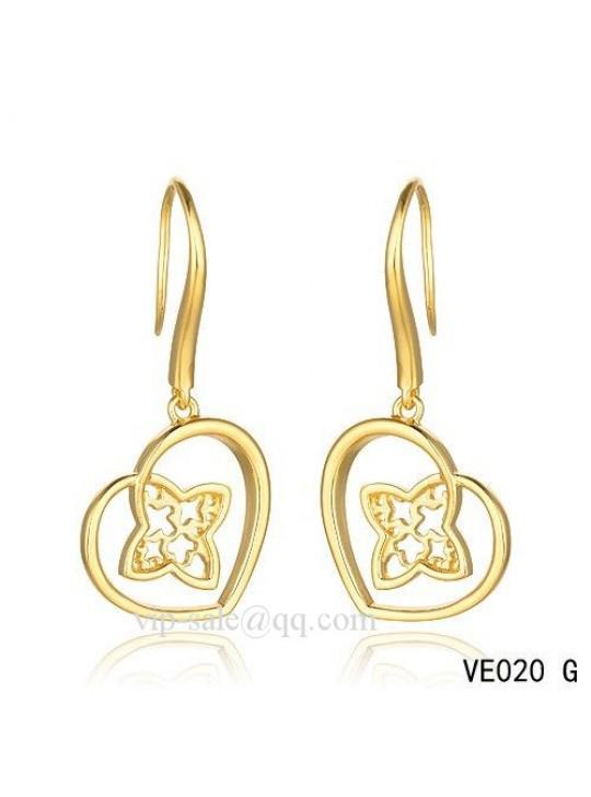 Louis Vuitton heart earrings in yellow