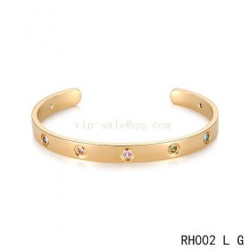 Cartier Love open Bracelet in yellow gold with colroed stones
