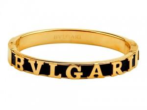 Bvlgari black leather bangle in yellow gold