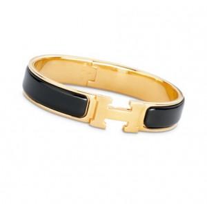 7e5d08a869ed ... Hermes Black Enamel Clic H Narrow Bracelet in Yellow Gold