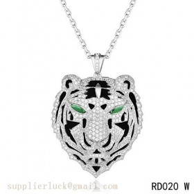 Panthere de Cartier Leopard head pendant in white gold with emeralds and diamonds