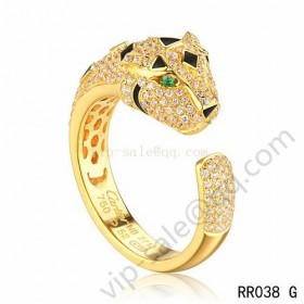 Cartier panther motif ring in yellow gold with diamonds emerald