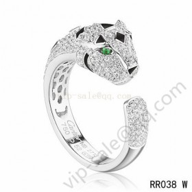 Cartier panther motif ring in white gold with diamonds emerald
