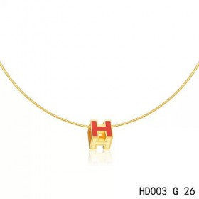 Hermes Cage d'H  pendant dark orange in lacquer with yellow gold