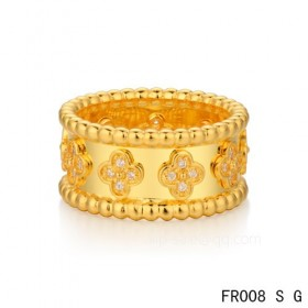 Van Cleef and Arpels clover ringIn yellow with round diamonds