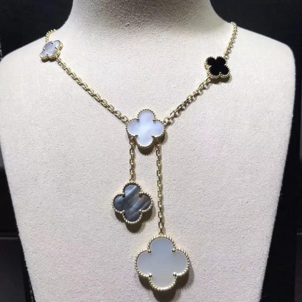 Van Cleef & Arpels Magic Alhambra necklace, 6 motifs, yellow gold, white and gray mother-of-pearl, onyx.