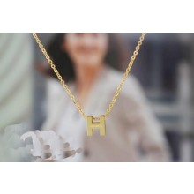 """Hermes """"H"""" letter cham with O chain necklace, 18k yellow gold"""